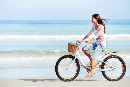 Girl Riding Bicycle on Beach
